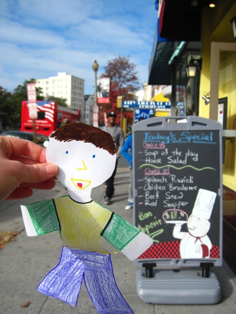 The good thing about walking? It loves to coach along a hearty appetite. Flat Stanley said he had a hankerin' for Italian. And with a sidewalk sandwich board advertising spinach ravioli on special—who can blame him?